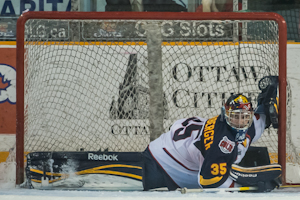 April 13th, 2012, Ottawa : Barrie Colts goalie Mathias Niederberger ((35) streches to make a save in the second period against the Ottawa 67s at the J. Benson Cartage arena. The 67s won over the Colts by a score of 2.1.
